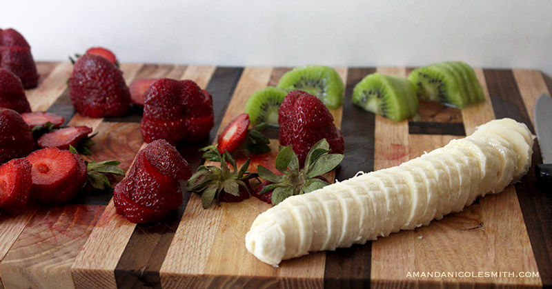 Sliced strawberries, kiwis, and bananas